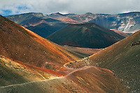 This  rugged and barren wilderness landscape in the crater of HALEAKALA NATIONAL PARK on Maui in Hawaii is a hiking challenge