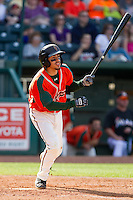 Alfredo Lopez (7) of the Greensboro Grasshoppers follows through on his swing against the Delmarva Shorebirds at NewBridge Bank Park on May 26, 2013 in Greensboro, North Carolina.  The Grasshoppers defeated the Shorebirds 11-2.  (Brian Westerholt/Four Seam Images)