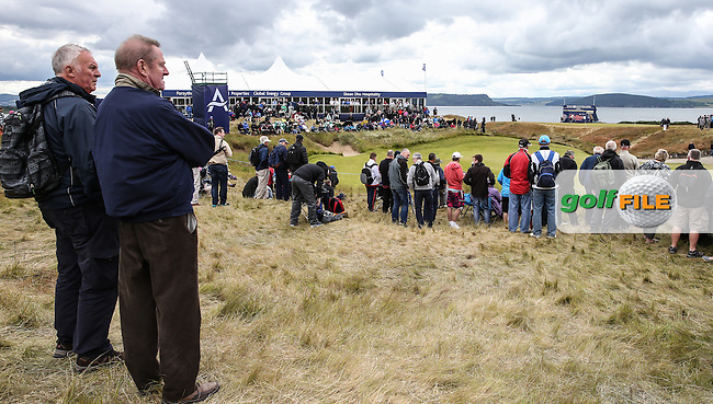 View of the 14th green where a good sized crowd has gathered, during Round Two of the 2016 Aberdeen Asset Management Scottish Open, played at Castle Stuart Golf Club, Inverness, Scotland. 08/07/2016. Picture: David Lloyd | Golffile.<br /> <br /> All photos usage must carry mandatory copyright credit (&copy; Golffile | David Lloyd)