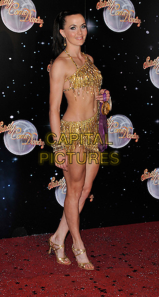 Victoria Pendleton.The Strictly Come Dancing 2012 Launch at the BBC, Wood Lane, London, England..September 11th, 2012 .full length dress side gold belly stomach midriff fringed skirt top.CAP/WIZ.© Wizard/Capital Pictures.