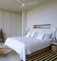 The contemporary guest bedroom has been furnished with locally sourced African artefacts