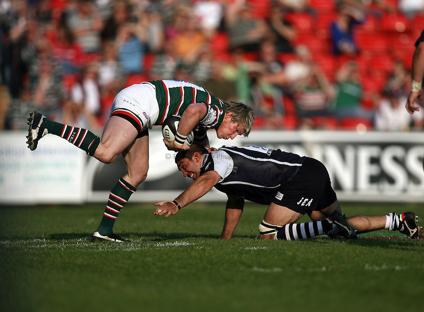 Photo: Rich Eaton...Leicester Tigers v Bristol Rugby. Guinness Premiership. 05/05/2007. Leicester's Ollie Smith (lt) is tackled by Bristol's Joe El Abd.