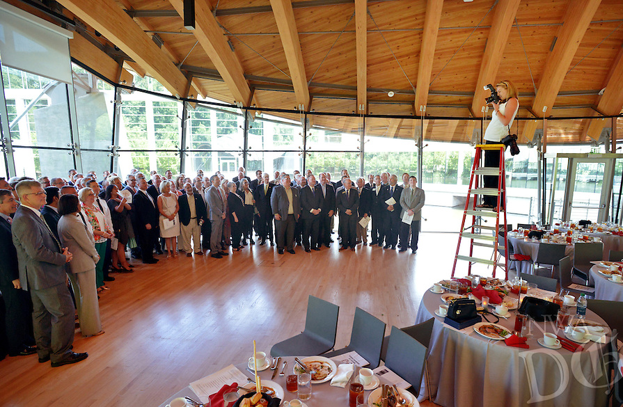 NWA Democrat-Gazette/BEN GOFF &bull; @NWABENGOFF<br /> Beth Hall of Beth Hall Photography takes a group picture of guests on Monday July 20, 2015 as the Northwest Arkansas Council celebrates its 25th anniversary at its summer annual meeting at Crystal Bridges Museum of American Art in Bentonville.