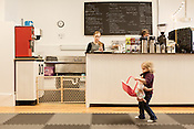 February 15, 2013. Durham, North Carolina. Owner Emily McCall readies a snack while Nora Berklich, age 2, plus with some available toys.. Stay & Play is a combination indoor playground and coffee shop where parents can bring their kids to play while they enjoy a drink or snack.