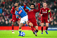 Napoli's Allan vies for possession with Liverpool's Mohamed Salah<br /> <br /> Photographer Richard Martin-Roberts/CameraSport<br /> <br /> UEFA Champions League Group C - Liverpool v Napoli - Tuesday 11th December 2018 - Anfield - Liverpool<br />  <br /> World Copyright © 2018 CameraSport. All rights reserved. 43 Linden Ave. Countesthorpe. Leicester. England. LE8 5PG - Tel: +44 (0) 116 277 4147 - admin@camerasport.com - www.camerasport.com