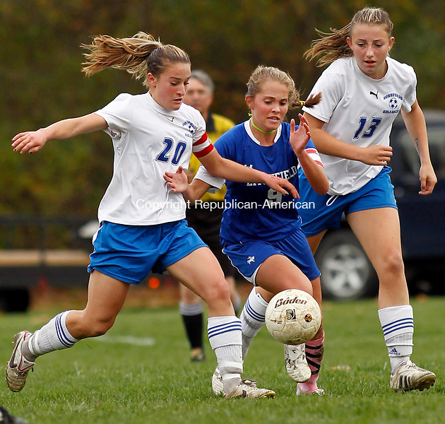 Woodbury, CT- 26, October 2010-102610CM10  Litchfield's Marissa Quesnel (#9) battles Nonnewaug's Georgia Gibson (#20), Katie Burke (#13) Tuesday afternoon in Woodbury. Nonnewaug blanked the Cowboys 5-0.  Christopher Massa Republican-American