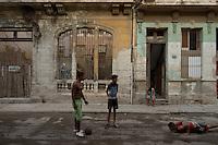 people playing soccer , street scene in Havana, Cuba,