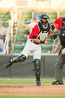 Kannapolis Intimidators catcher Michael Marjama (12) makes a throw to third base against the Lexington Legends at CMC-Northeast Stadium on July 29, 2013 in Kannapolis, North Carolina.  The Intimidators defeated the Legends 10-5.  (Brian Westerholt/Four Seam Images)