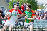Kevin McCarthy Kilcummin and Ger Hartnett Mid Kerry in action in the SFC in Killorglin on Sunday