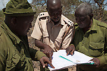 Big Life anti-poaching patrol with patrol reports, Mbirikani group ranch, Chyulu Hills, Amboseli-Tsavo ecosystem, Kenya, October 2012