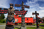 Colorful totem poles and CNR train car in downtown Duncan, City of Totems, Cowichan Valley, Vancouver Island, British Columbia, Canada 2017.