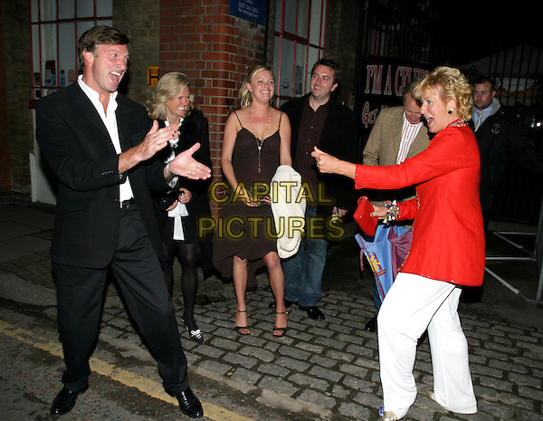 LORD BROCKETT & CHRISTINE HAMILTON.I'm A Celebrity...Get Me Out Of Here! - third anniversary party. Delfina gallery, 50 Bermondsey Street, SE1.full length, full-length, gesture, fighting, funny.www.capitalpictures.com.sales@capitalpictures.com.© Capital Pictures.