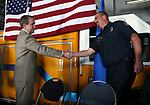 Carson City Mayor Bob Crowell congratulates Wildland Fuels Management Officer Rodd Rummel during a badge-pinning ceremony at Carson Fire Department in Carson City, Nev., on Monday, Oct. 16, 2017. <br /> Photo by Cathleen Allison/Nevada Momentum