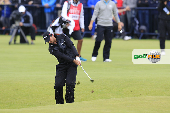 Jason DAY (AUS) plays his 2nd shot into the 18th green during Monday's Final Round of the 144th Open Championship, St Andrews Old Course, St Andrews, Fife, Scotland. 20/07/2015.<br /> Picture Eoin Clarke, www.golffile.ie