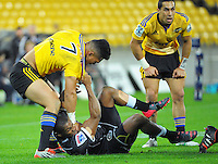 Ardie Savea gets to know Sibusiso Sithole better during the Super Rugby match between the Hurricanes and Sharks at Westpac Stadium, Wellington, New Zealand on Saturday, 9 May 2015. Photo: Dave Lintott / lintottphoto.co.nz