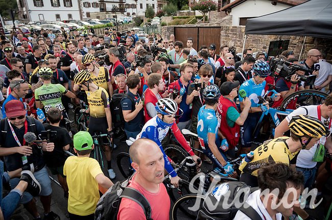 pure chaos at the stage finish; riders, soigneurs, fans, press & organisers simply blocked in the small street that was the finish line<br /> <br /> Stage 11: Saint-Palais to Urdax-Dantxarinea (180km in The Basque Country > FRA & ESP) <br /> La Vuelta 2019<br /> <br /> ©kramon