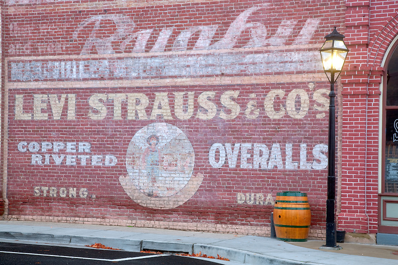Old Levi sign on side of brick building. Jacksonville, Oregon