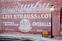 Old Levi sign on side of brick building. Jacksonville, Oregon