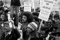 1975 Jan. 15. Photograph shows Jesse Jackson surrounded by marchers carrying signs advocating support for the Hawkins-Humphrey Bill for full employment.around the White House