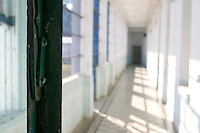 South America, Argentina, La Plata, Los Olmos. Freedom Behind Bars, Prison and Divinity - The corridor to the living space in Unit 25 of Los Olmos Prison. Los Olmos Prison is one of the principal security prisons in Argentina. It hosts Unit 25, known as Christ the Only Hope Prison Church, one of the largest prison churches worldwide. The transformation of criminals into the God fearing and leading them to the Lord has taken hold, not only in the lives of inmates, but also in inmate families and prison guards. Once the countries worst killers and thieves have since become spiritual leaders to other criminals, creating a revolutionary spiritual rehabilitation, July 2006 &copy; Stephen Blake Farrington<br />