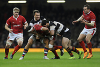 Wales Aaron Shingler is tackled by Barbarians Marco Van Staden<br /> <br /> Photographer Ian Cook/CameraSport<br /> <br /> 2019 Autumn Internationals - Wales v Barbarians - Saturday 30th November 2019 - Principality Stadium - Cardifff<br /> <br /> World Copyright © 2019 CameraSport. All rights reserved. 43 Linden Ave. Countesthorpe. Leicester. England. LE8 5PG - Tel: +44 (0) 116 277 4147 - admin@camerasport.com - www.camerasport.com