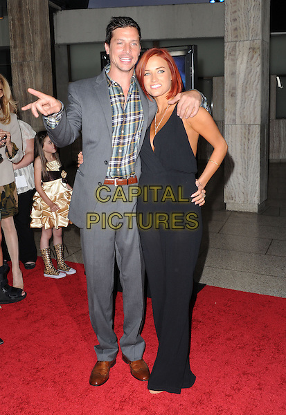 Simon Rex & Guest .at The Dimension Films Premiere of 'Scary Movie 5' held at The Cinerama Dome in Hollywood, California, USA, April 11th 2013.                                                               .full length suit hand black sheer dress hand on hip gesture catsuit  grey gray plaid checked shirt .CAP/DVS.©Debbie VanStory/Capital Pictures