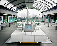 The museum in The Wellcome Trust Millennium Building at the Millennium Seed Bank at Wakehurst Place in West Sussex. The building houses facilities for seed-preparation, laboratories and public exhibitions. There is a large storage vault which lies underneath the building. The Millennium Seed Bank Partnership is coordinated by Kew Gardens and aims to collect seeds from every wild plant in the world to insure against extinction. It reached its target of banking seeds from all of the UK's native plant species as well as banking 10% of the world's wild plant species in 2009, and aims to have 25% by 2020.