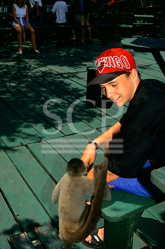 Ariau Tower Jungle Lodge Hotel, Rio Negro, Amazonas State, Brazil. Boy and woolly monkey.