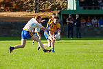 Craig Hickey Spa challenges Michael John O'Connor Beaufort during their County League clash in Beaufort on Friday night