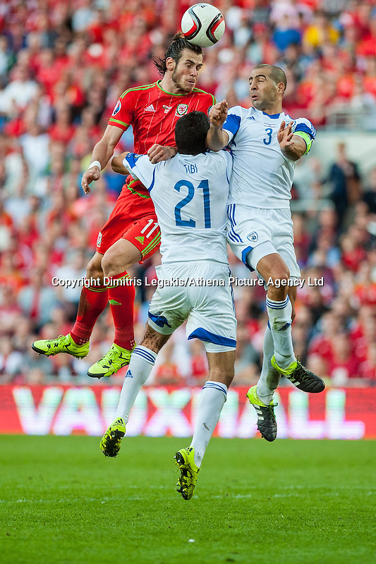 Gareth Bale  of Wales  heads the ball towards goal in the dying minutes of the game during their UEFA EURO 2016 Group B qualifying round match held at Cardiff City Stadium, Cardiff, Wales, 06 September 2015. EPA/DIMITRIS LEGAKIS
