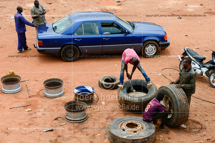 BURKINA FASO, Bobo Dioulasso, roadside car workshop, tyre repairing