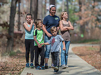 NWA Democrat-Gazette/ANTHONY REYES @NWATONYR<br /> Ryder Raines, 4, (center) leads the way for his family Raelynn, 9, (from left), Ramsey, 6, Sherine Raines, and Rylee, 10, all of Pea Ridge Tuesday March 21, 2017 at Hobbs State Park in Rogers. The family was at the park to enjoy the nice weather and learn a little about the park and nature. The park has several spring break activities planned through the week including scavenger hunts and nature hikes. Contact the visitors center (479) 789-5000 for more information.