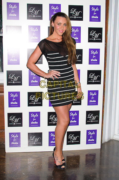 Michelle Heaton  .Style for Stroke Launch Party held at No.5 Cavendish Square, London, England..October 2nd 2012..full length white black sheer stripe dress hand on hip.CAP/CJ.©Chris Joseph/Capital Pictures.