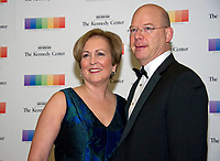 Trombonist Peter Ellefson, right, and guest arrive for the formal Artist's Dinner honoring the recipients of the 40th Annual Kennedy Center Honors hosted by United States Secretary of State Rex Tillerson at the US Department of State in Washington, D.C. on Saturday, December 2, 2017. The 2017 honorees are: American dancer and choreographer Carmen de Lavallade; Cuban American singer-songwriter and actress Gloria Estefan; American hip hop artist and entertainment icon LL COOL J; American television writer and producer Norman Lear; and American musician and record producer Lionel Richie.  <br /> Credit: Ron Sachs / Pool via CNP /MediaPunch
