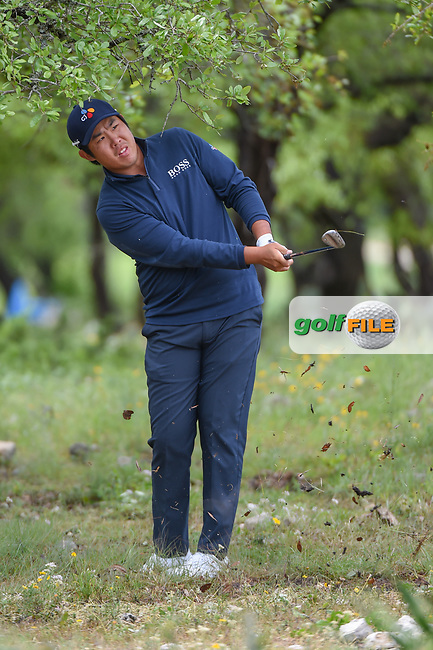 Byeong Hun An (KOR) chips on to 12 from the trees during day 4 of the Valero Texas Open, at the TPC San Antonio Oaks Course, San Antonio, Texas, USA. 4/7/2019.<br /> Picture: Golffile | Ken Murray<br /> <br /> <br /> All photo usage must carry mandatory copyright credit (© Golffile | Ken Murray)