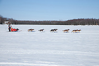 Anitra Winkler on Willow lake heads towards the finish of the Jr. Iditarod   Willow, Alaska
