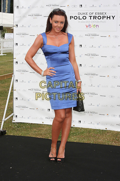 MICHELLE HEATON .Duke Of Essex Polo Trophy at Gaynes Park, Epping, Essex, England, UK,.July 4th 2009..full length blue dress hand on hip bracelet ring silver cross necklace black peep toe shoes Dior bag .CAP/ROS.©Steve Ross/Capital Pictures