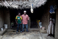 PEMBA, TANZANIA - DECEMBER 7 : Hamissi Usi, age 15, with his father Sabki in their home on December 7, 2010 on Pemba, Tanzania. He works as a fisherman. He doesn't go to school but lives with his parents and siblings in the small village of Tumbe. (Photo by: Per-Anders Pettersson)