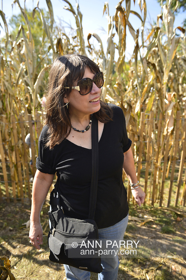 Old Bethpage, New York, USA. September 28, 2014. LAURA YORBURG, of Yorktown Heights, is looking for the right path that leads to the corn field maze exit, at the 172nd Long Island Fair, a six-day fall county fair held late September and early October. A yearly event since 1842, the old-time festival is now held at a reconstructed fairground at Old Bethpage Village Restoration.