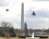 Washington, DC - February 16, 2009 -- Marine 1 and a decoy, with United States President Barack Obama and his family aboard, prepare to land on the South Lawn of the White House after the Obamas spent a week-end in Chicago, Illinois on Monday, February 16, 2009..Credit: Ron Sachs - Pool via CNP
