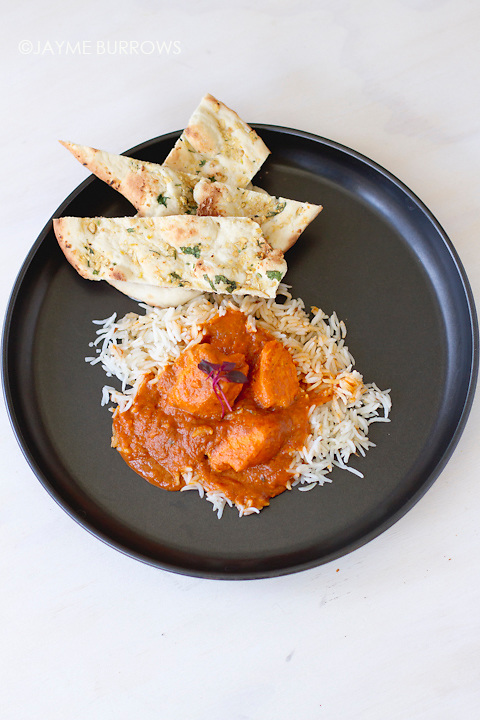 An Indian food dish of tikka masala and basmati rice.