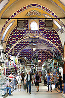 General view through the arcade of Grand Bazaar, 15th century, Istanbul, Turkey. The Grand Bazaar, containing two bedestens (storage domes) is one of the largest and oldest covered markets in the world, selling jewellery, pottery, spice, and carpets. It was restored in the 16th and 19th centuries. Picture by Manuel Cohen.