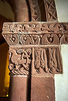Norman Romanesque chancel arch capital of the church of St Peters, Rowlstone, Herefordshire, England. The relief sculptures are attributed to the Herefordshire School of stonemasons. The style draws upon Anglo-Saxon and celtic designs. The capital depicts a bird in decorative foliage, two angels one of which is holding a book are shown upside down, possible a reference to how St Peter, to whom the church is dedicated, was crucified.