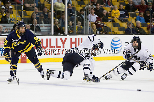 Ryan Flanigan (Merrimack - 20), Mike Sislo (UNH - 19), Brett Kostolansky (UNH - 15) - The Merrimack College Warriors defeated the University of New Hampshire Wildcats 4-1 (EN) in their Hockey East Semi-Final on Friday, March 18, 2011, at TD Garden in Boston, Massachusetts.