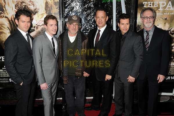 "CAST & CREW - James Badge Dale, Joe Mazzello, Stephen Spelberg, Tom Hanks, Jon Seda and Gary Goetzman.HBO's ""The Pacific"" Mini-Series Premiere held at Grauman's Chinese Theatre, Hollywood, California, USA..February 24th, 2010.full length grey gray facial hair baseball cap hat  white black pinstripe .CAP/ADM/BP.©Byron Purvis/AdMedia/Capital Pictures."