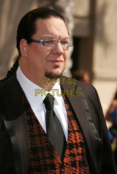 PENN JILLETTE - PENN & TELLER.2006 Primetime Creative Arts Emmy Awards held at the Shrine Auditorium, Los Angeles, California, USA..August 19th, 2006.Ref: ADM/RE.headshot portrait goatee glasses .www.capitalpictures.com.sales@capitalpictures.com.©Russ Elliot/AdMedia/Capital Pictures.