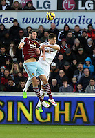 Pictured L-R: Andy Carroll of West Ham against Federico Fernandez of Swansea Saturday 10 January 2015<br />