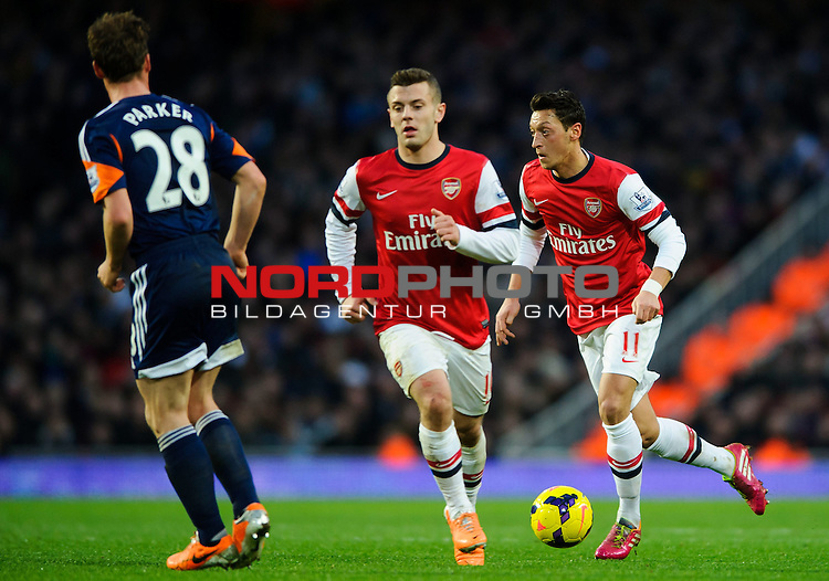 Arsenal Midfielder Mesut Ozil (GER) and Midfielder Jack Wilshere (ENG) in action during the match -  - 18/01/14 - SPORT - FOOTBALL - Emirates Stadium - Arsenal v Fulham - Barclays Premier League.<br /> Foto nph / Meredith<br /> <br /> ***** OUT OF UK *****
