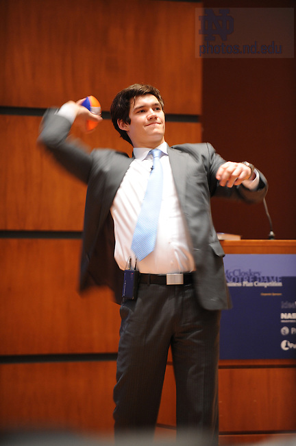 "A presenter from ""Dormbooks"" throws nerf balls into the audience during the final event of the McCloskey Business Plan competition, April 18, 2008."