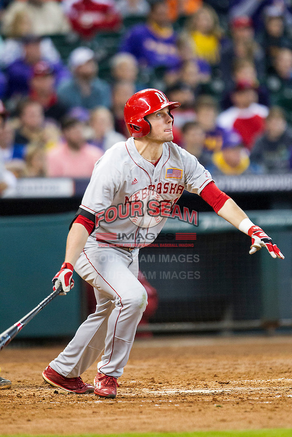Nebraska Cornhuskers outfielder Ryan Boldt (21) follows through on his swing during the Houston College Classic against the LSU Tigers on March 8, 2015 at Minute Maid Park in Houston, Texas. LSU defeated Nebraska 4-2. (Andrew Woolley/Four Seam Images)